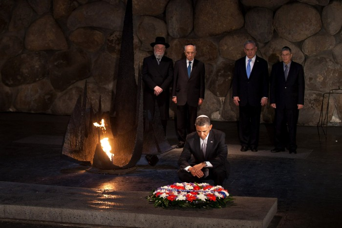 President Obama paying his respects in the Hall of Remembrance at the Yad Vashem Holocaust Museum in Jerusalem. In the back, left to right, Rabbi Yisrael Meir Lau, Israeli President Shimon Peres, Israeli Prime Minster Benjamin Netanyahu and Chairman of the Yad Vashem Directorate Avner Shalev, March 22, 2013. (Photo by Uriel Sinai/Getty Images)