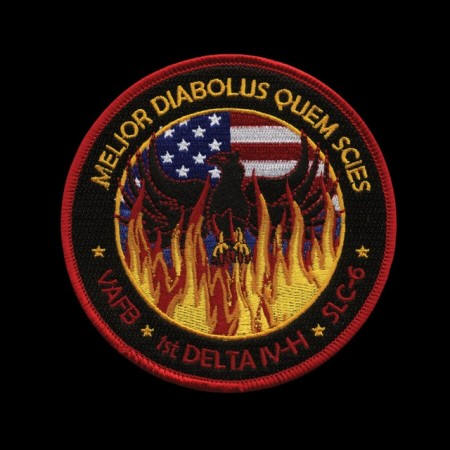 "PHOENIX RISING FROM THE ASHES IN NASA PATCH FOR NROL-48. THE LATIN PHRASE MEANS ""THE DEVIL YOU KNOW"""